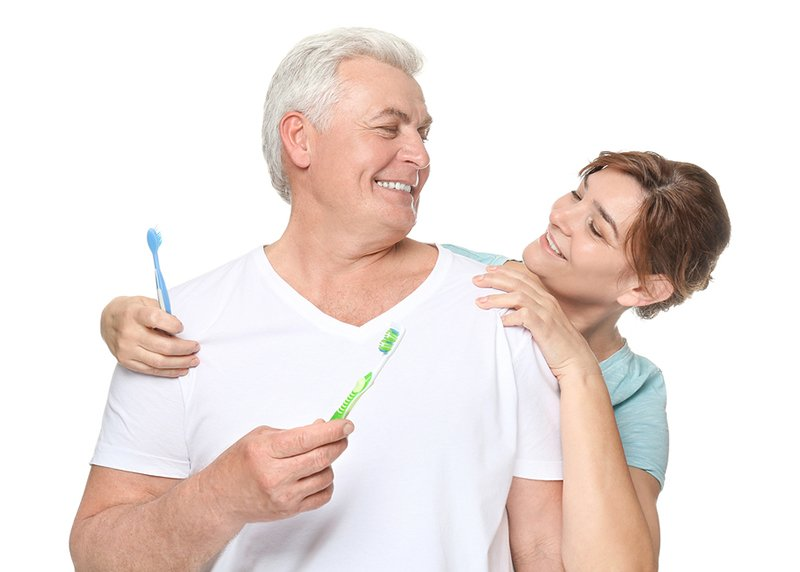 Senior couple with toothbrushes